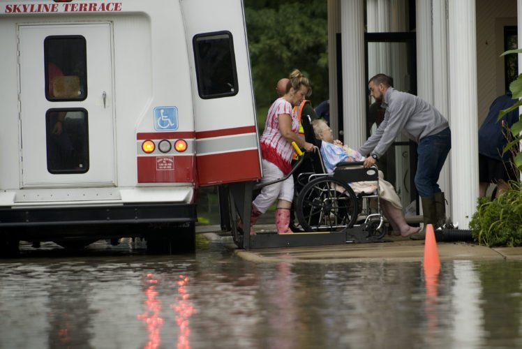 A resident of Greenfield of Woodstock is placed on the wheelchair lift of this van during the evacuation from the facility on Monday morning.  Rich Cooley/Daily